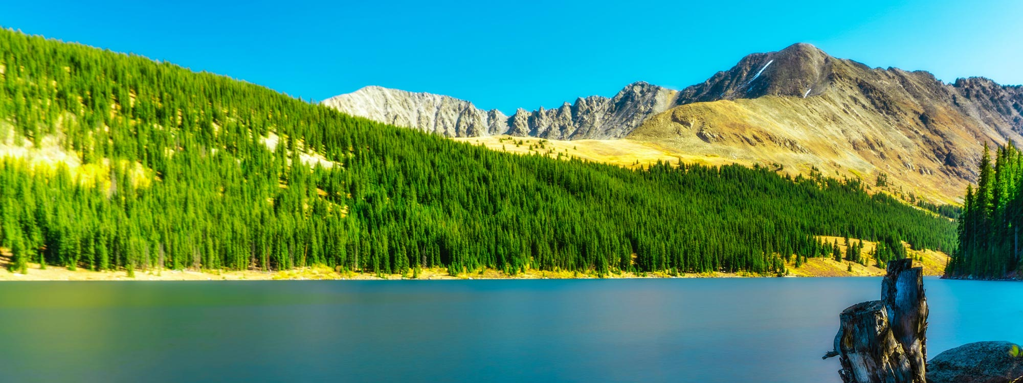 Scenic view of mountains across a lake